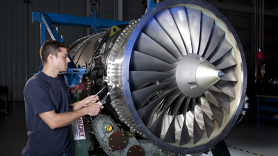 Technician working on Tay engine